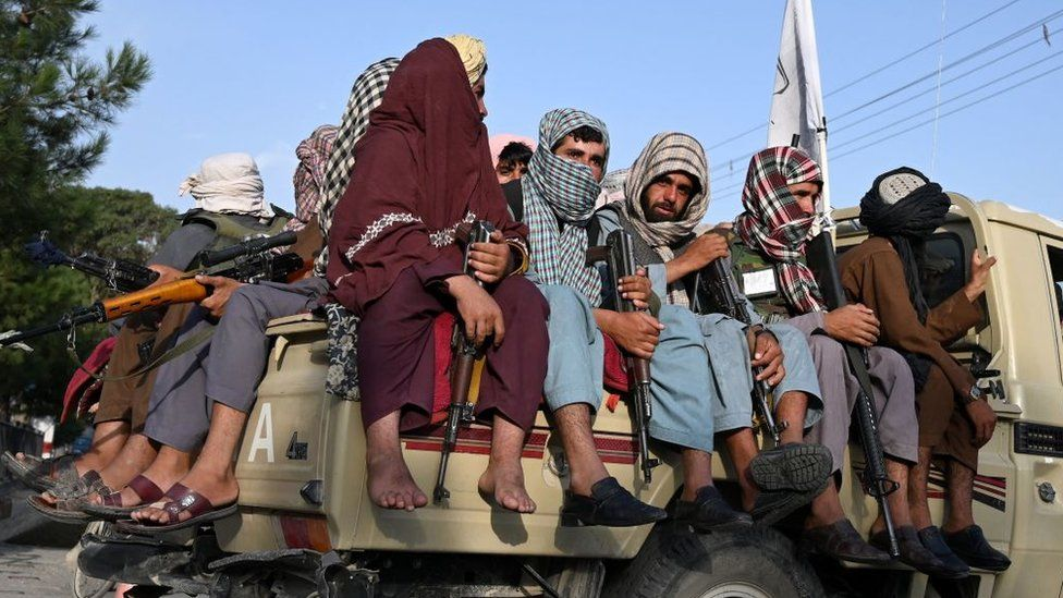 Taliban fighters in a vehicle patrol the streets of Kabul on August 23, 2021