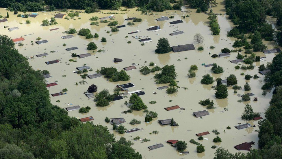 This file photo taken on 6 June 2013 shows an aerial view of summer houses flooded by water from the River Danube near the Bavarian village Deggendorf, southern Germany