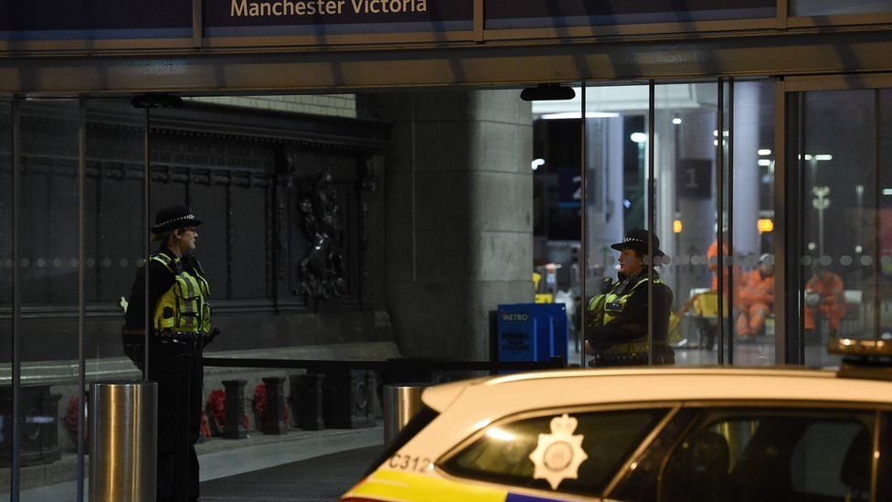 Officers on guard inside the station