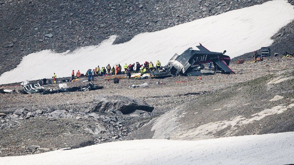 Accident investigators and rescue personnel work at the wreckage of a Junkers JU52 aircraft in Flims in eastern Switzerland on 5 August 2018.