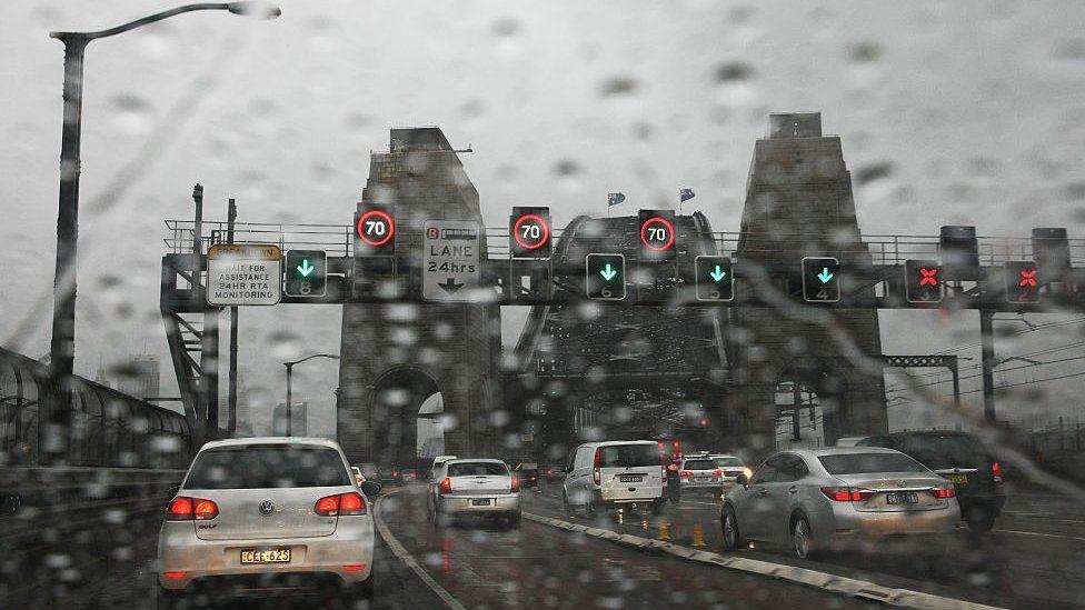 Heavy traffic across the Harbour Bridge on a rainy day