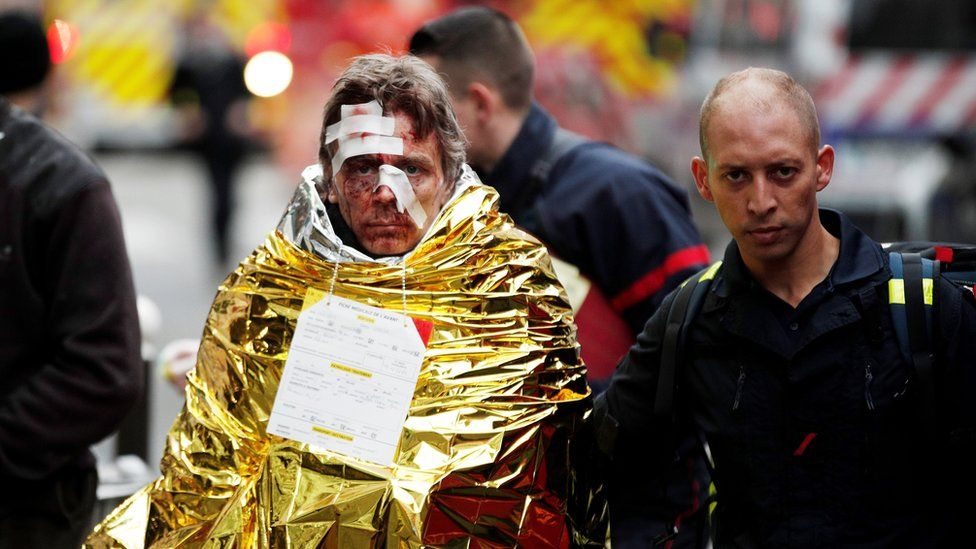Emergency personnel help injured persons at the scene of an explosion at a bakery near Rue de Trevise in Paris, France, 12 January 2019.