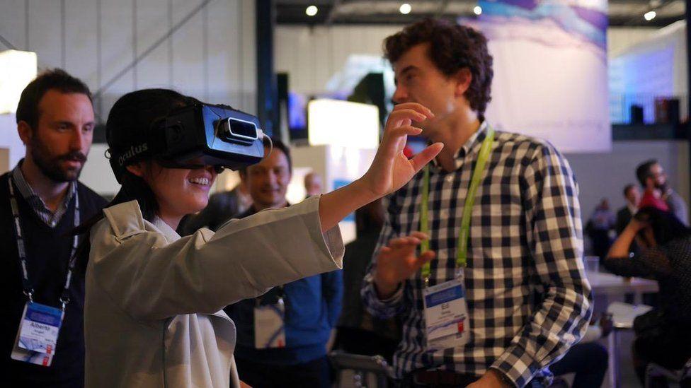Woman wearing Deloitte's VR headset