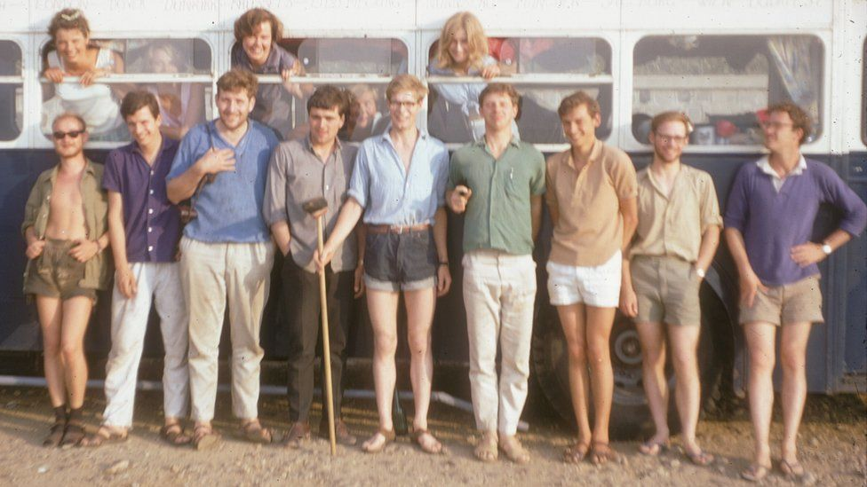 Hanging out of the windows (l-r): Sarah Lowe, Wendy Scott, Rosemary Stanning. Just visible in the bus: Carol Cave and Margaret Hardisty (Hills). Outside: Roland Lisker, Klemens Hedenig, Dick Moore, Bryan Powell, Ian Jack, Dave Stickland, Mike Hughes, Nigel Hungerford, Sandy Scott
