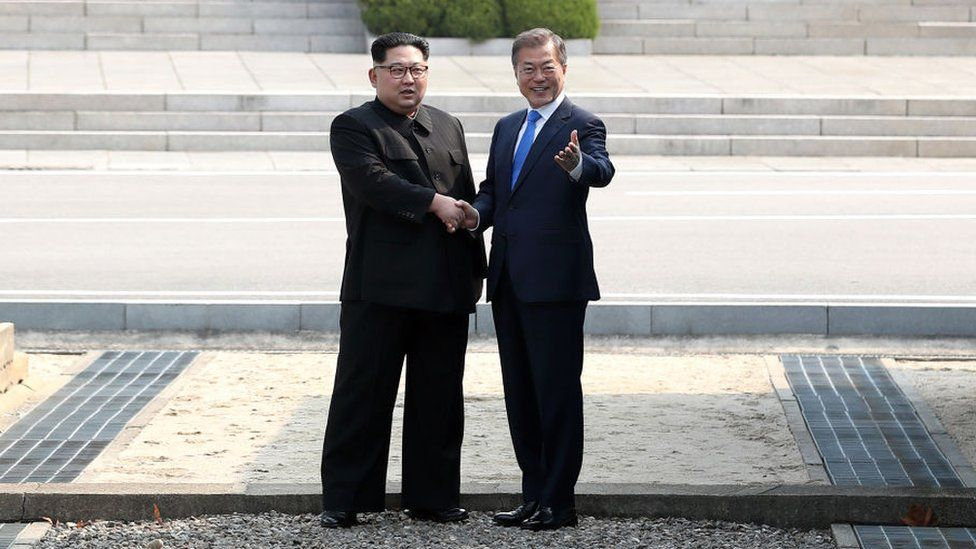 Kim Jong-un and Moon Jae-in shake hands in the JSA, April 2018
