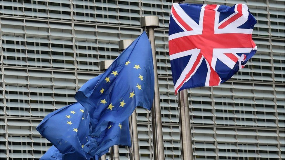Union Jack and EU flags fly at Brussels