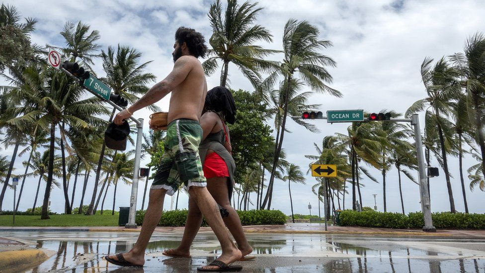 People walk on Ocean Dr in Miami beach, Florida, USA, 01 August 2020
