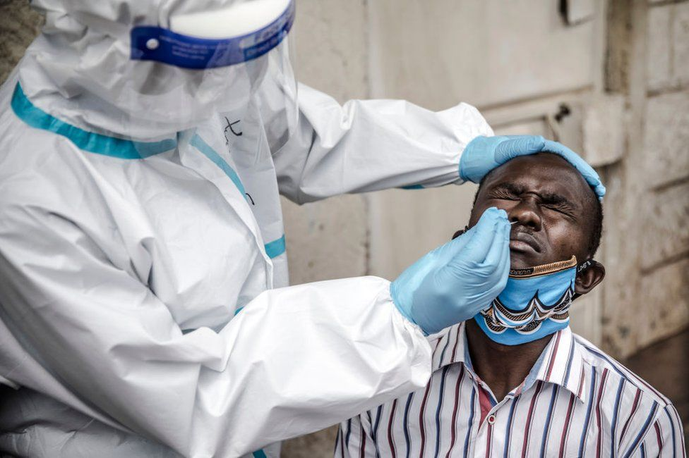 A man gets a nasal swab in Kenya