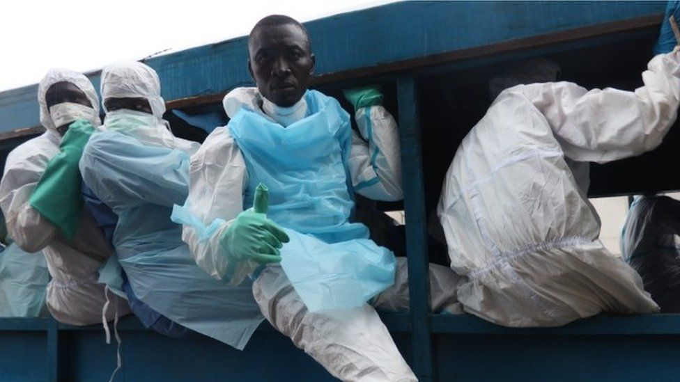 Dozens of volunteers like Jibrila Sesay are playing a central role in the gruesome clear-up operation