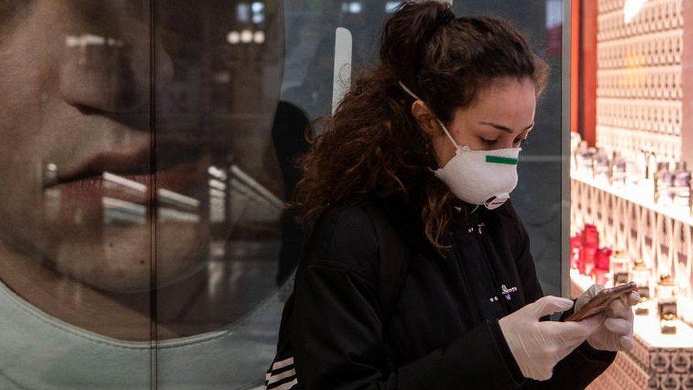 Woman checking her phone in Milan