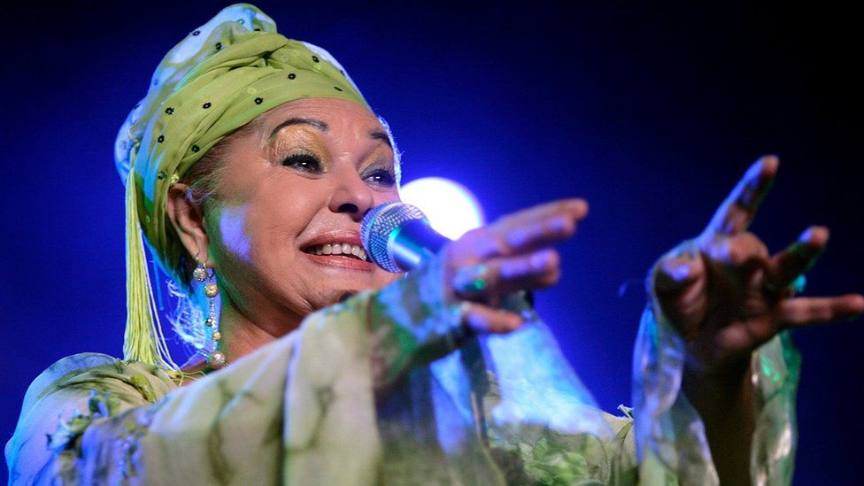 Esma Redzepova performs in Switzerland in 2006, dressed in a bright green turban