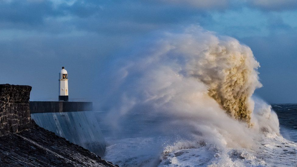 Storm causes large waves to hit coastal pier