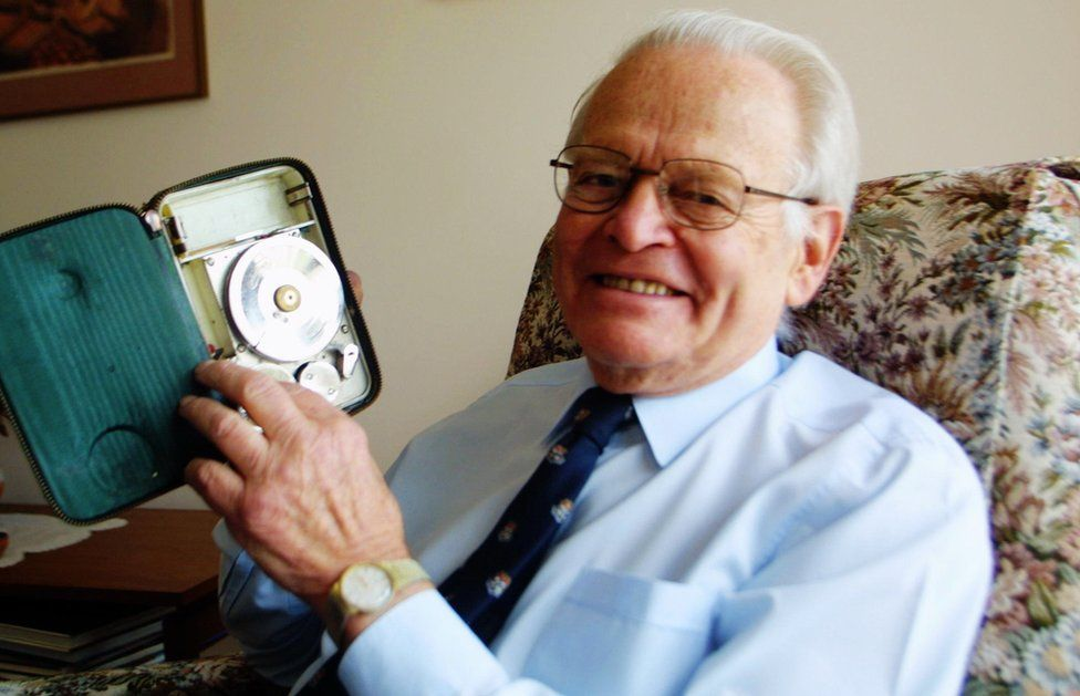 David Warren, pictured in 2002, holds the first combined voice/data recorder