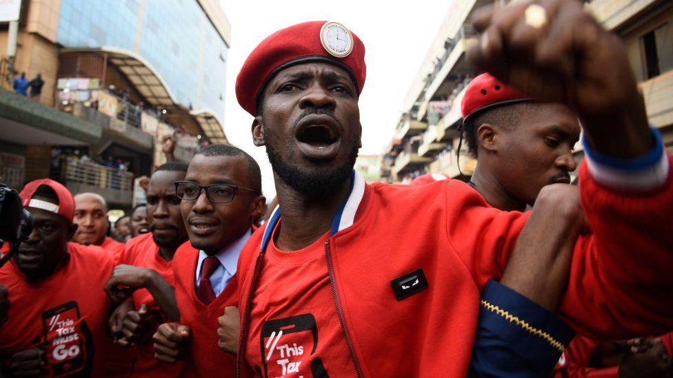 Bobi wine and activist protesting against the social media tax