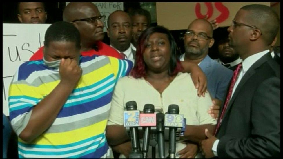 Family members of Alton Sterling, who was shot and killed at the hands of police, speal at a news conference.