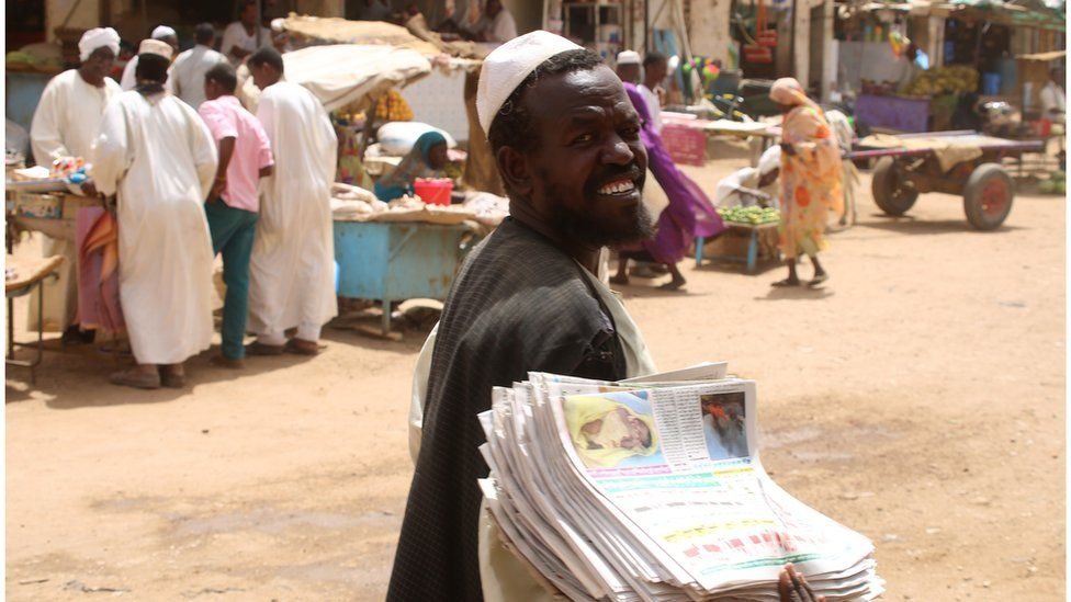 Newspaper vendor in Sudan