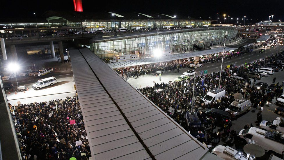 People gather for a protest at Terminal 4 of the John F. Kennedy (JFK) International Airport after people arriving from Muslim countries were held at the border control as a result of the new immigration policies enacted by US President Donald Trump in New York, New York, USA, 28 January 2017.