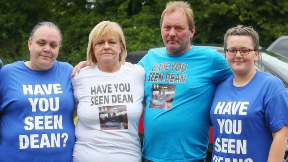 Dean McIlwaine's parents (centre) led a public search for their son on Saturday