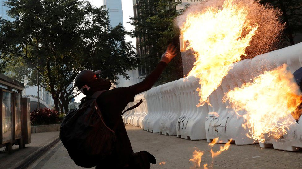 protester throws petrol bomb
