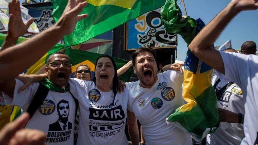 Supporters of Brazilian right-wing presidential candidate Jair Bolsonaro rally at Copacabana beach in Rio de Janeiro