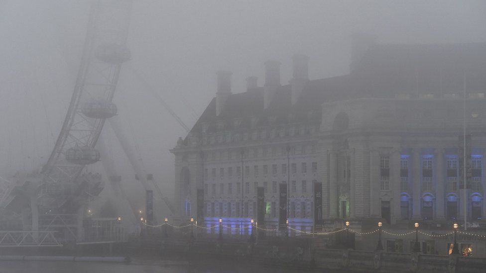 London Eye in thick fog