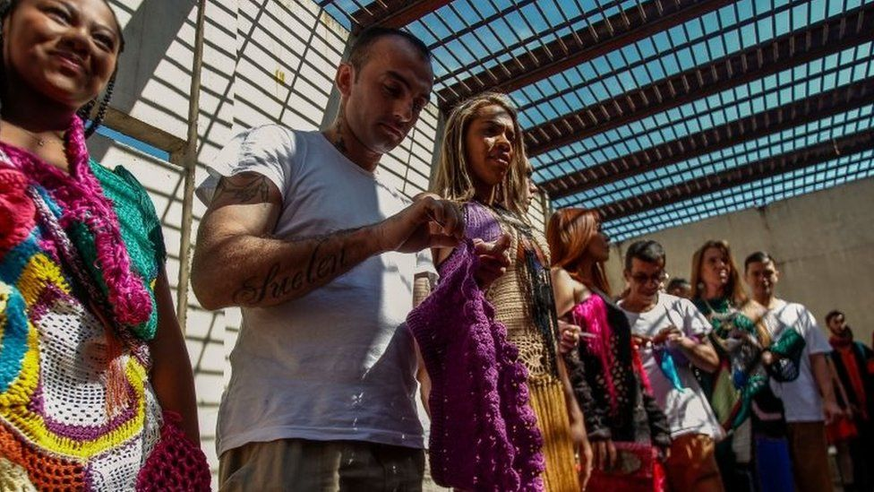 """An inmate crochets clothing as part of """"Ponto Firme"""" project in the Adriano Marrey maximum security penitentiary in Guarulhos, Brazil on May 22, 2019."""