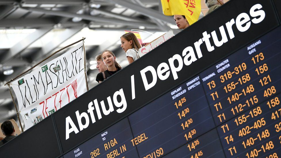 """People attend a """"Fridays for Future"""" protest, claiming for urgent measures to combat climate change, at Stuttgart airport, Germany July 26, 2019"""