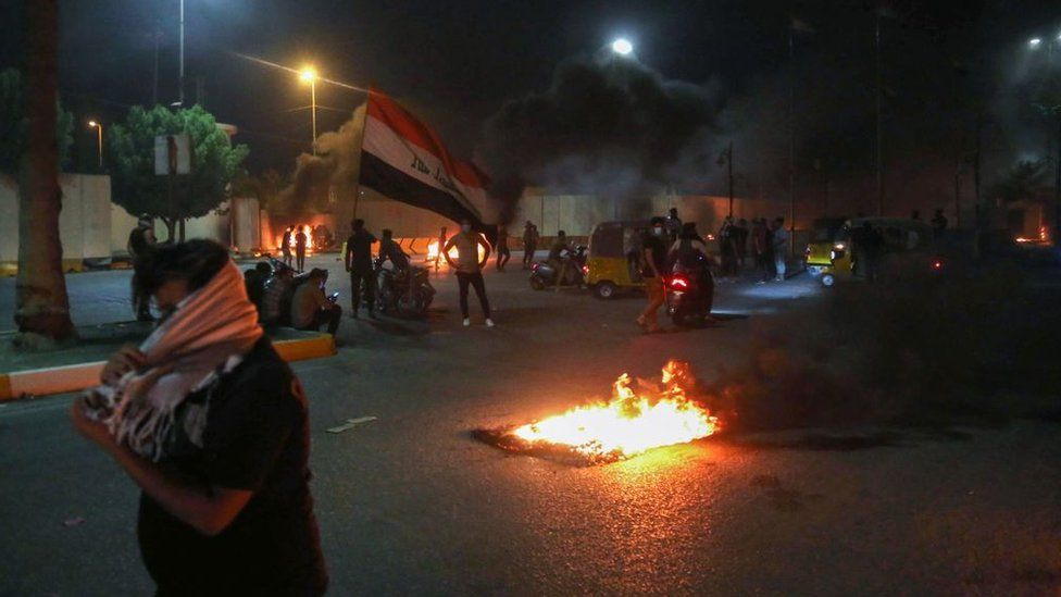Protesters set fire to the gates of the Iranian consulate's compound in Karbala on 9 May 2021