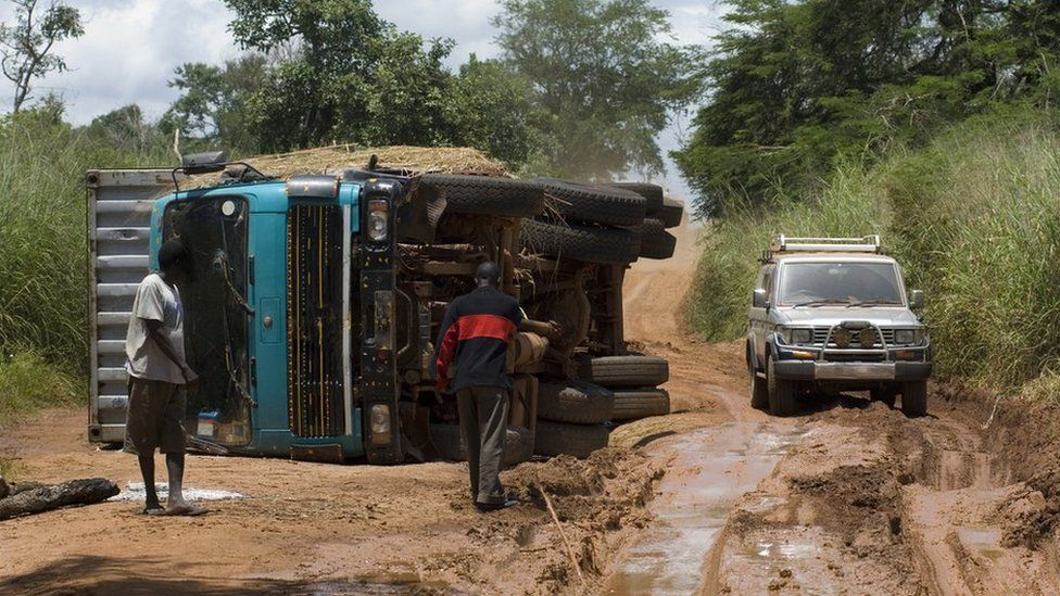 A truck flips over on a muddy road in Sudan