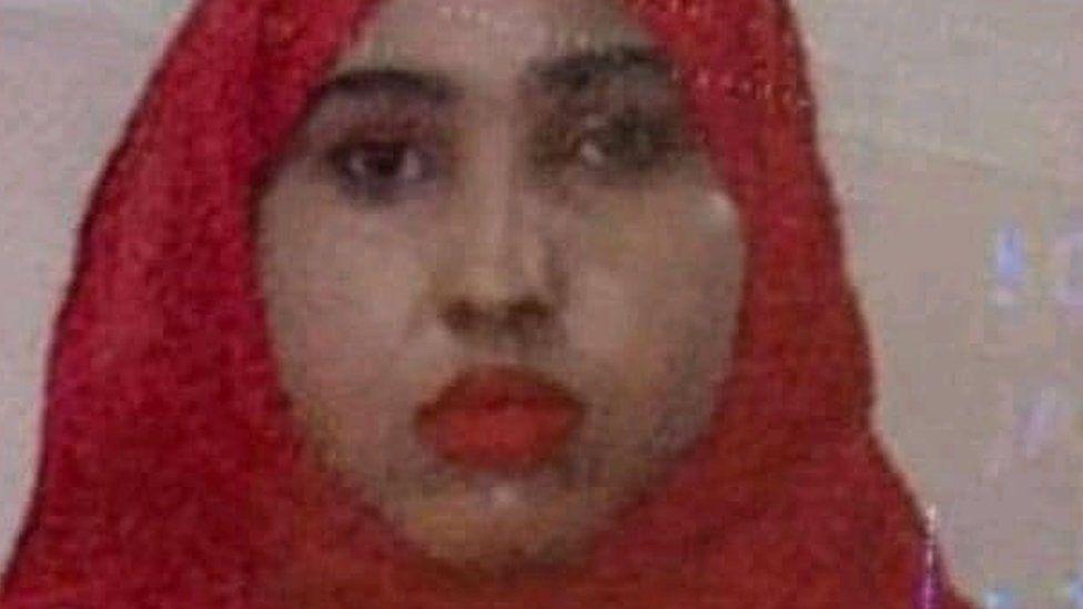 Ikraan Tahliil in red head scarf