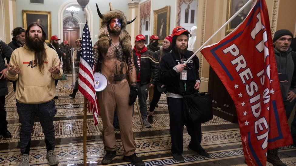 US Elections protest: Jacob Chansley (C) with other Pro-Trump supporters, as they demonstrate ouside Senate Chamber at the U.S. Capitol after breaching security, January 6th 2021