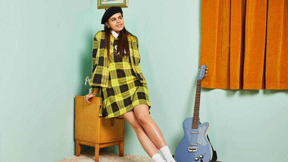 Asos model pictured with a guitar