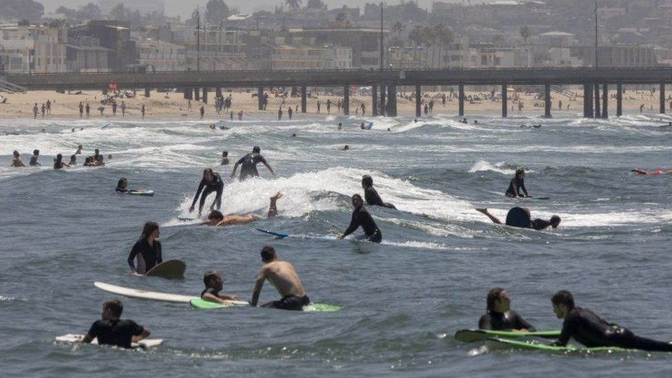 Surfers and beachgoers on Los Angeles' Venice Beach, California. Photo: 24 May 2020