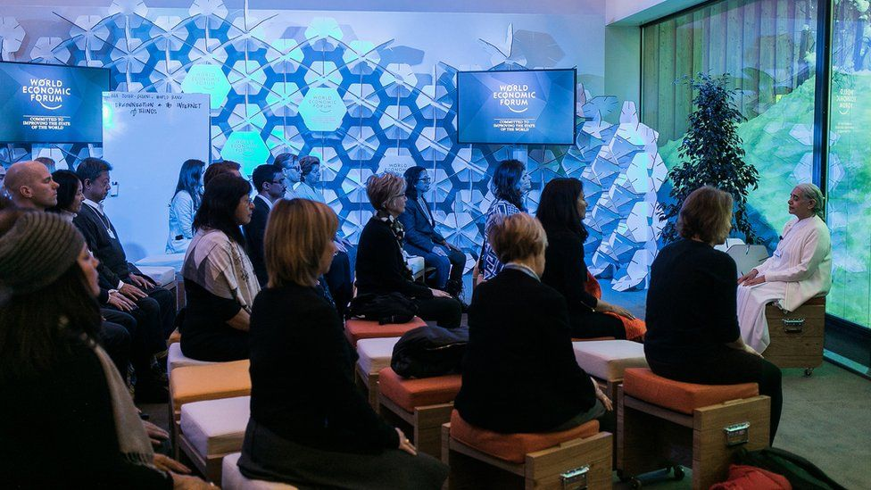 Delegates at Davos at a meditation session
