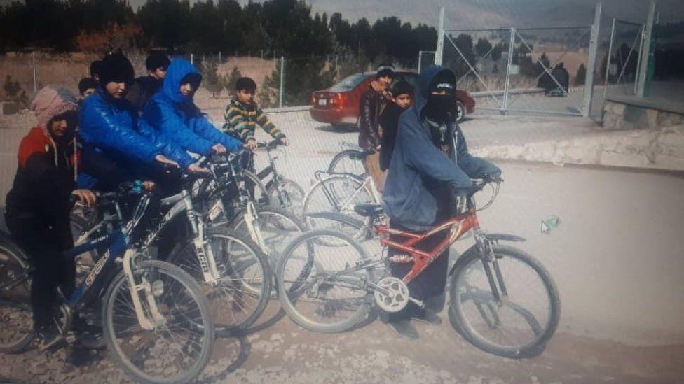 Sahba Barakzai, and a group of children out cycling