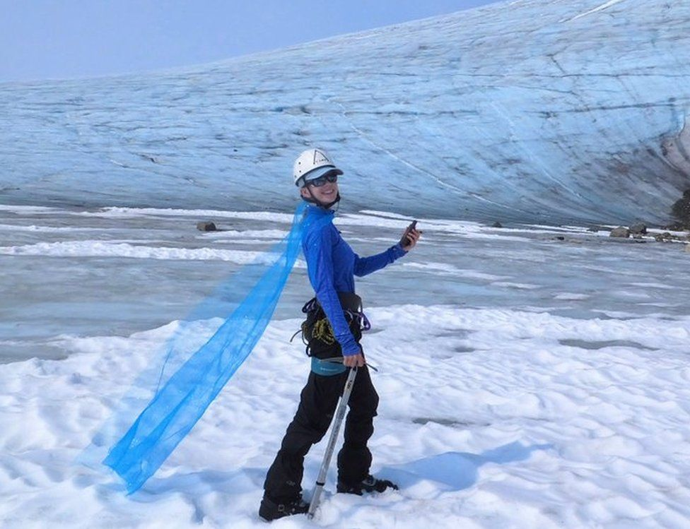 Celeste Labedz wearing a cape in front of a glacier
