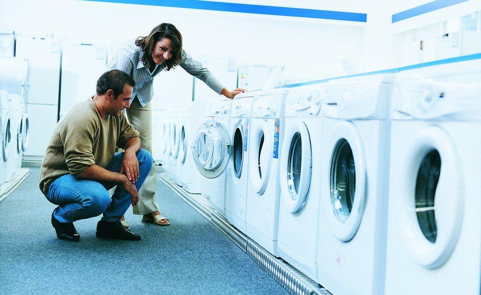 couple looking at washing machines