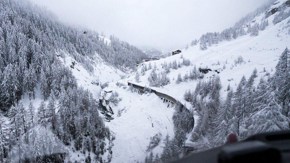 An avalanche crossing the railway track on the way between Taesch and Zermatt, in Zermatt, Switzerland, 09 January 2018.