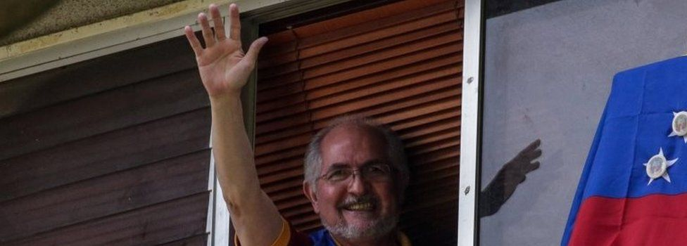Antonio Ledezma waves from a window of his residence in Caracas, Venezuela, 16 July 2017