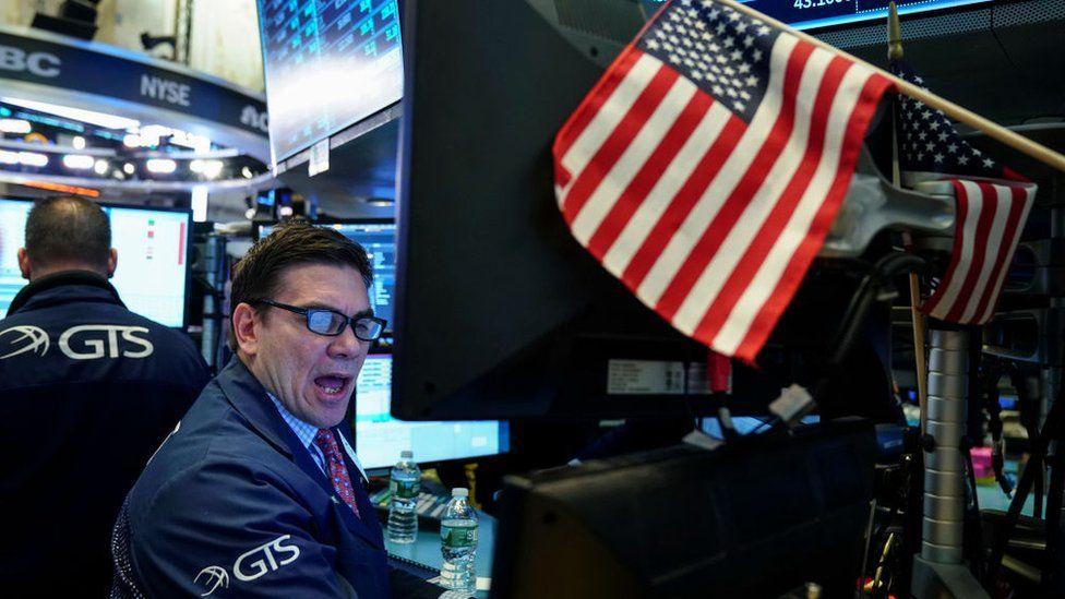 Wall Street trader and flag