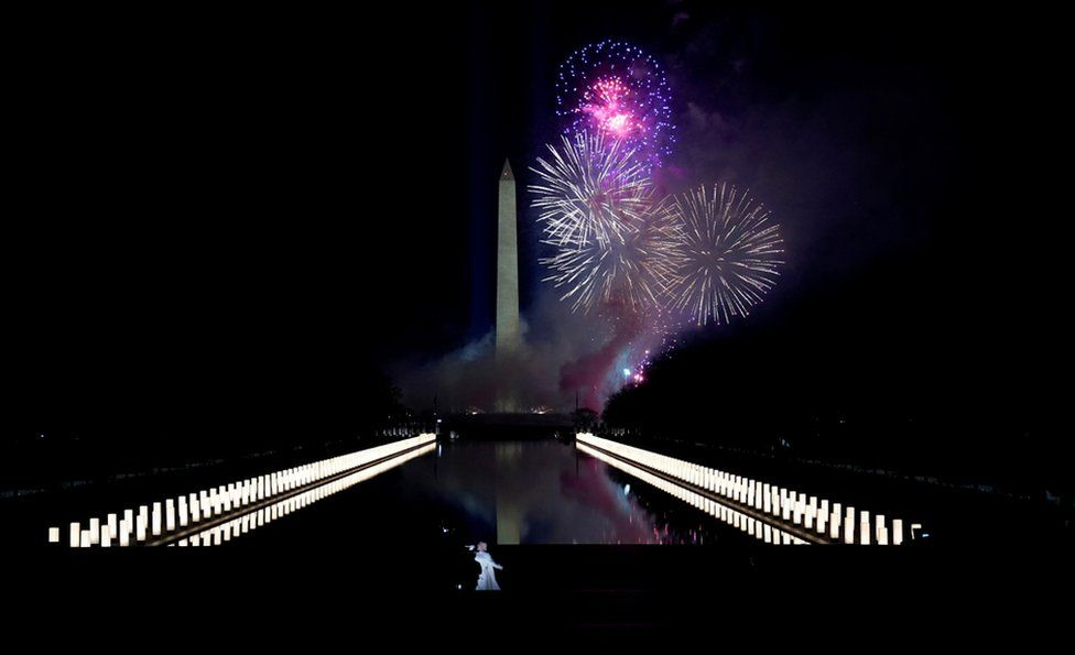 Katy Perry (foreground) performs amid the fireworks at the Washington Monument at a televised ceremony at the Lincoln Memorial on January 20, 2021 in Washington, DC.