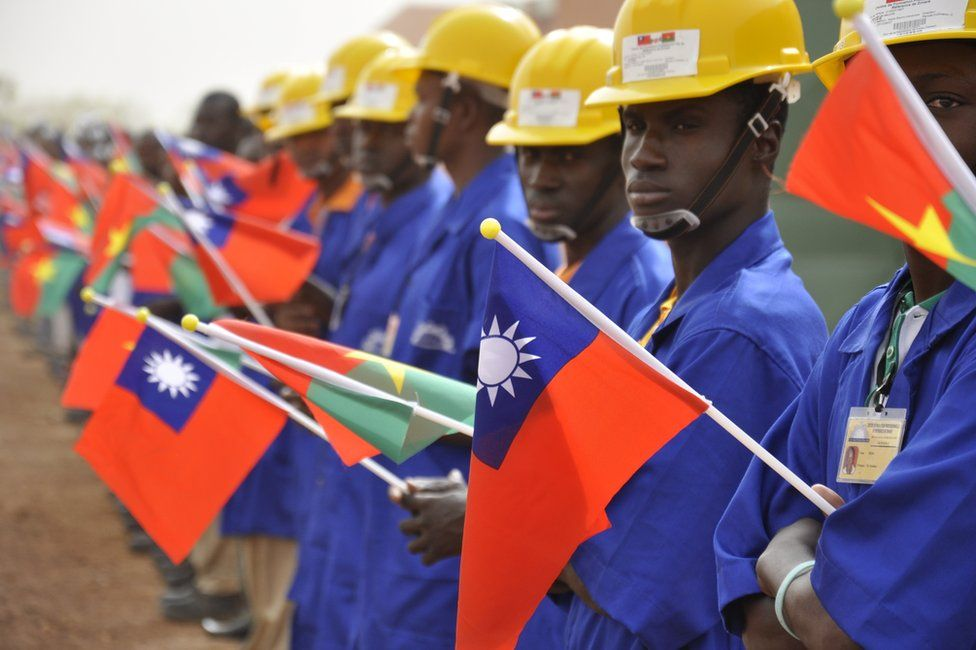 Students at the vocational training center of reference (Centre de formation professionnelle de reference de Ziniare (CFPR-Z)) in Ziniare, 35kms of Ouagadougou hold Taiwan's and Burkina Faso's flags during the visit of Taiwan's President on April 9, 2012. Taiwan's President Ma Ying-jeou is on a three-leg trip to Burkina Faso, Gambia and Swaziland.