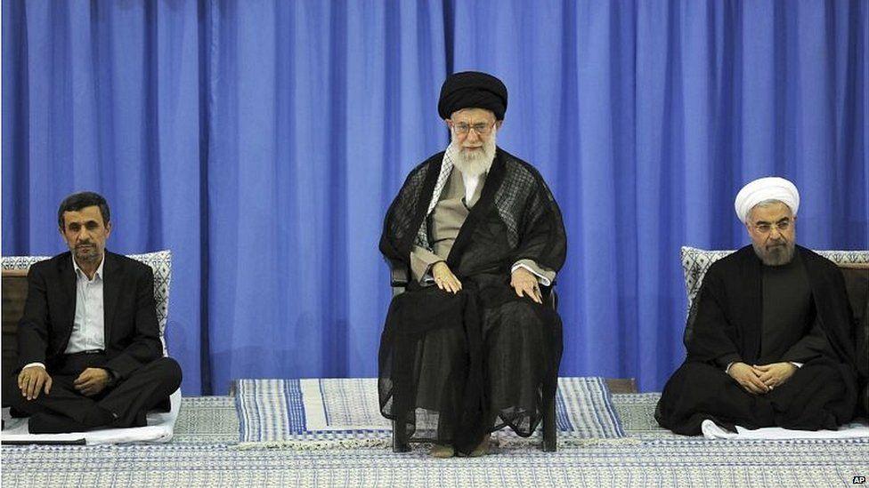 Mahmoud Ahmadinejad (left), Ayatollah Ali Khamenei (centre) and Hassan Rouhani (03/08/13)