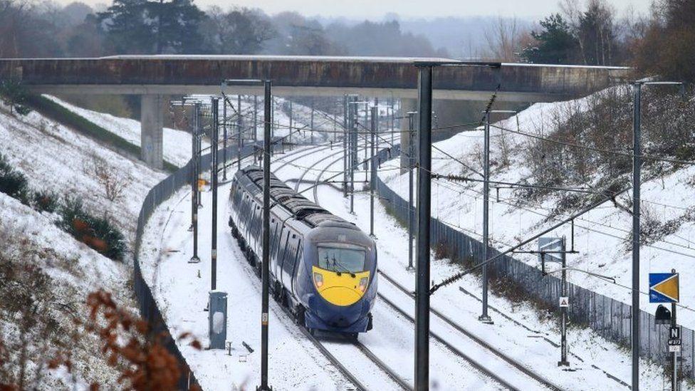 A train passes through Ashford in Kent
