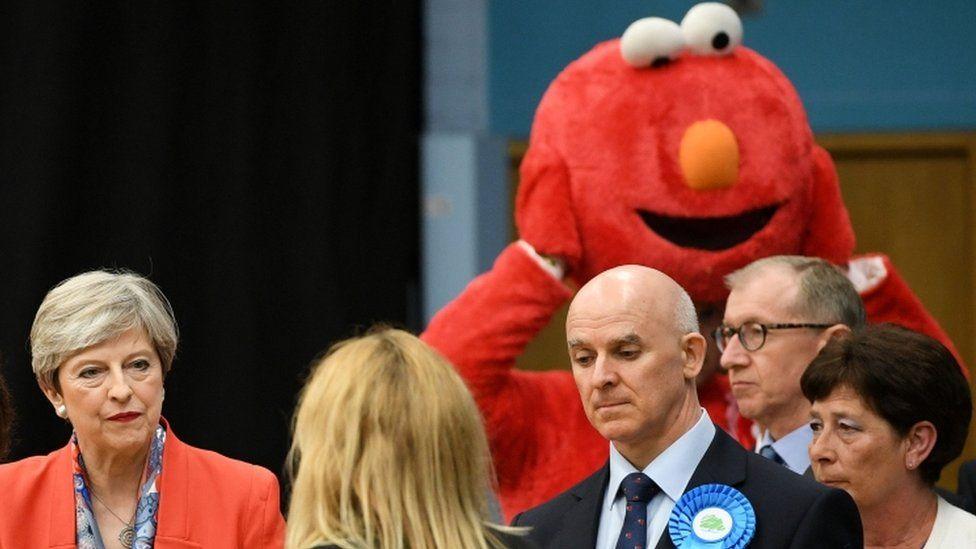 Theresa May and Elmo