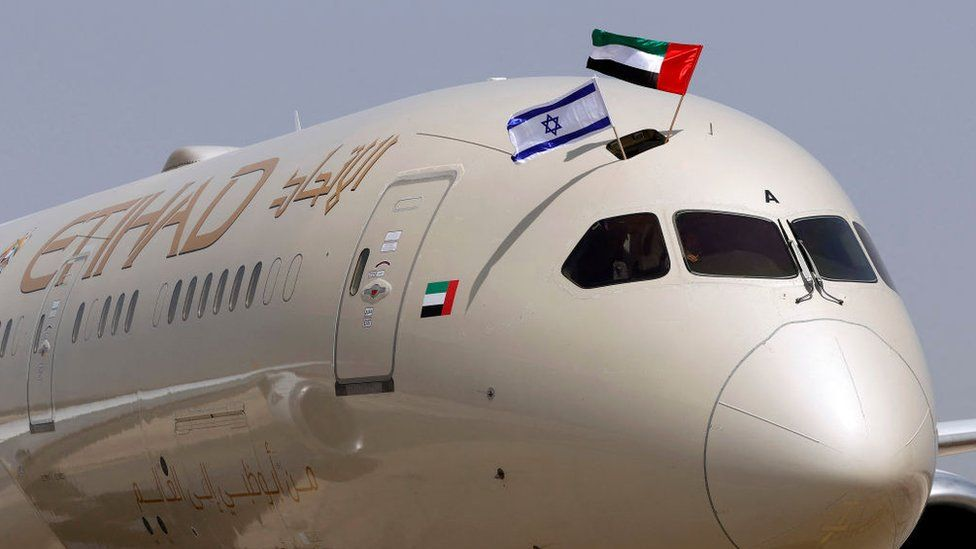 """An Etihad Airways Boeing 787-9 """"Dreamliner"""" aircraft displays Israeli and Emirati flags after landing upon arrival from the United Arab Emirates (UAE) at Israel's Ben Gurion Airport on 6 April"""