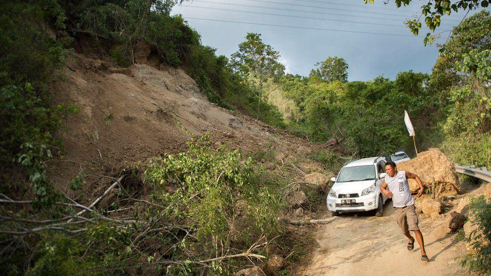 A landslide on a road outside Palu, 29 September
