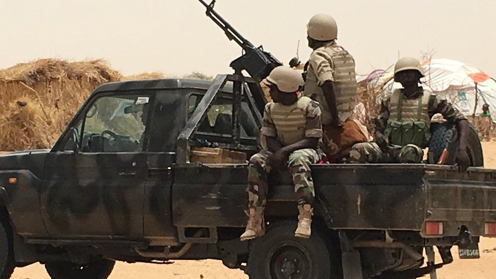 Niger soldiers on flatbed truck with mounted gun in Diffa, Niger