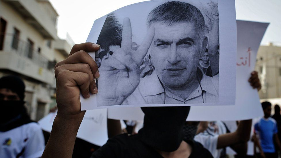 Bahraini Shia Muslim youth holds picture of rights activist Nabeel Rajab during demonstration in village of Daih, west of Manama, on June 11, 2012