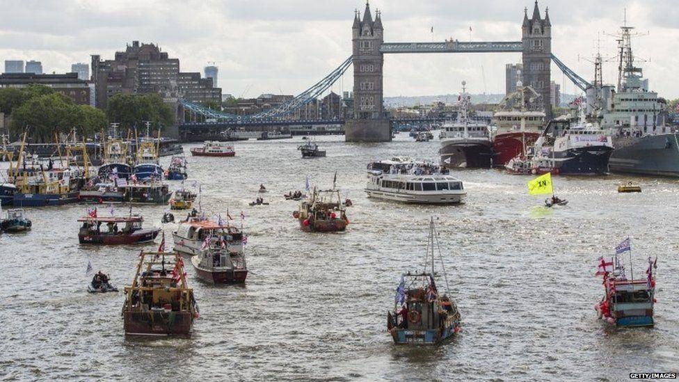 Flotilla of boats approaching Tower Bridge
